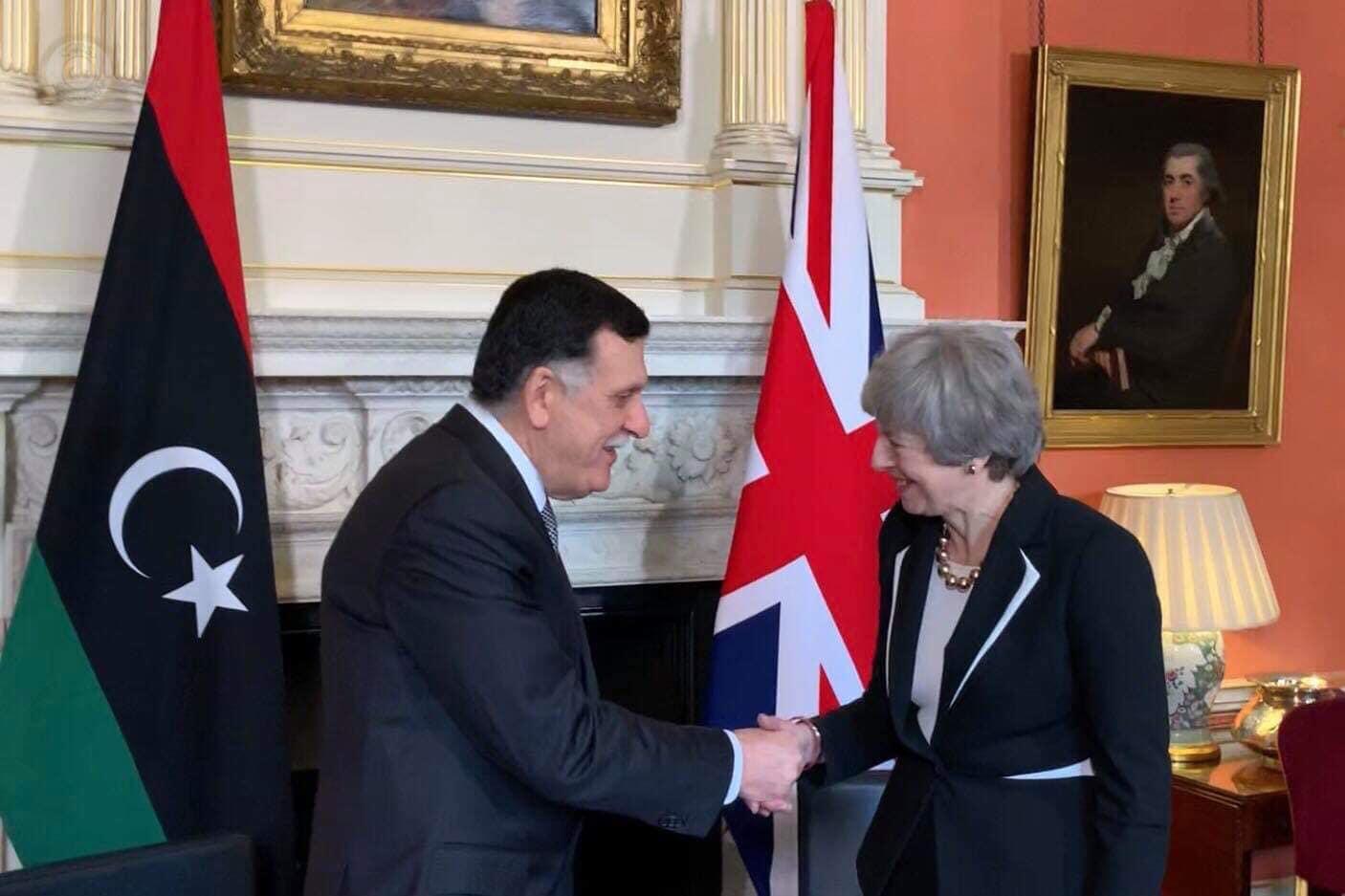 رئيسة الوزراء البريطانية تيريزا ماي ورئيس المجلس الرئاسي فائز السراج
