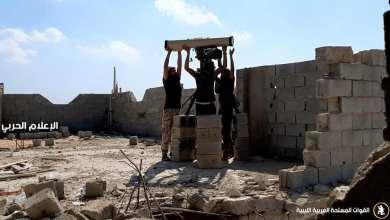 """جنود الجيش الوطني في إحدى محاور القتال - """"أرشيفية"""""""