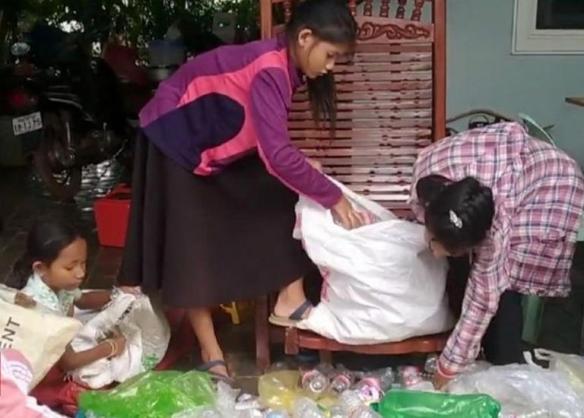 176-183033-cambodia-rubbish-school-kids-pay-plastic-3