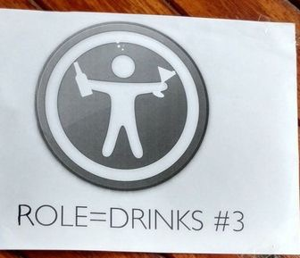 """A crude poster on a wooden door. Apple's """"Accessibility Guy"""" is holding a beer bottle and cocktail glass. Below it, """"role=drinks #3""""."""