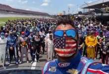 Photo of Drivers and Crew Stand With Bubba Watson at Talladega