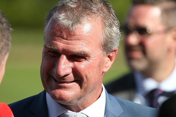 Melbourne Cup-winning horse trainer arrested as police raid stables