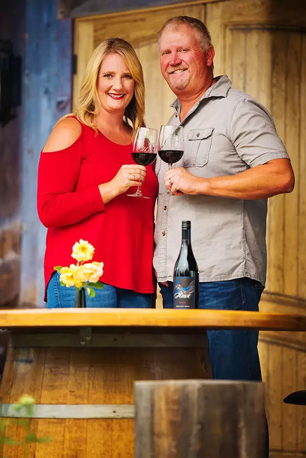 2Hawk Vineyard and Winery Owners Jen and Ross Allen with 9-1-1 Red Blend Wine