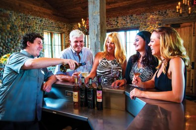 Wine Ambassador Pouring Wine in the 2Hawk Vineyard and Winery Tasting Room