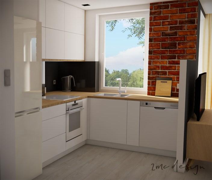 Kuchnia z dekorem cegły oraz czarnym szkłem nad drewnianym blatem