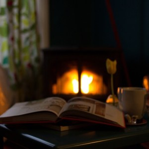 An open book in front of a fireplace - it must be hygge