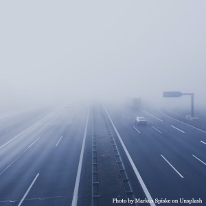 Dense fog a head on a highway