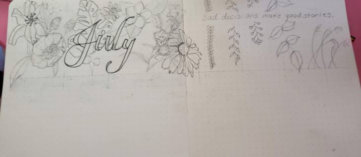 Bullet journal July weekly spread with detailed flowers and plants.