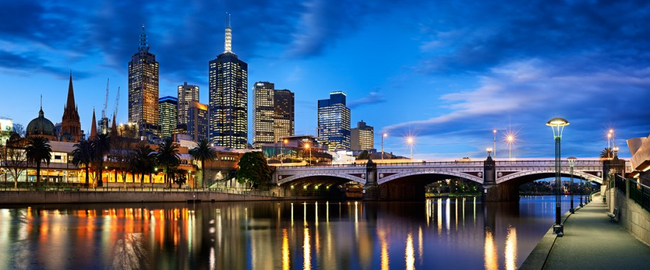 Vibrant sky behind river, bridge and high rise buildings - Melbourne