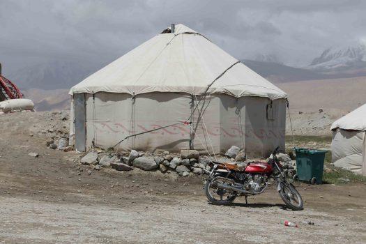motorbike kyrgyz locals at karakul lake