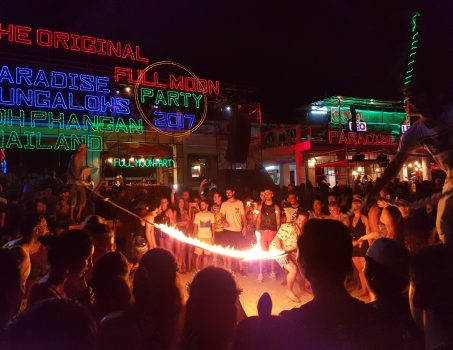 Flaming rope skipping in full moon party