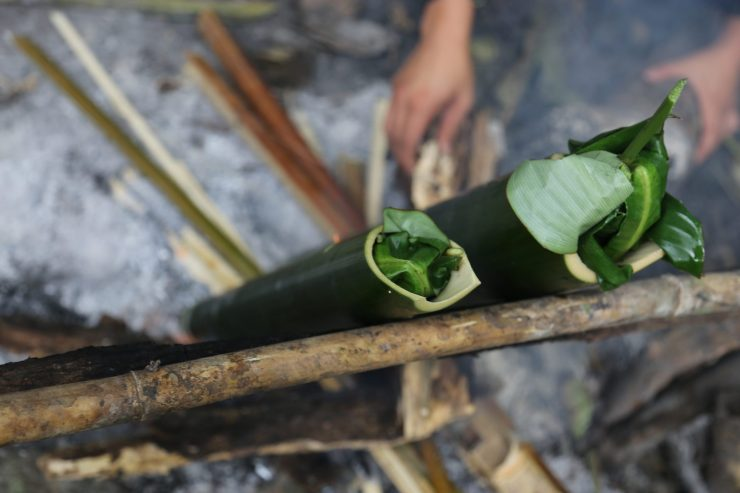 No metal pots required. Instead, bamboo is used to hold and cook green curry.