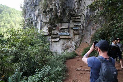 The local townspeople still practice burial in hanging coffins on the side of cliffs