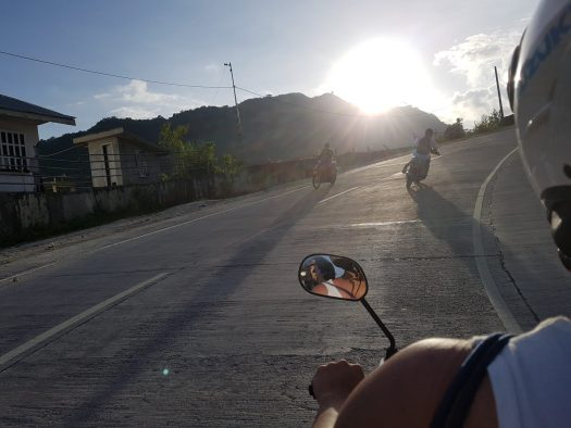 Riding a scooter up to Osmeña Peak