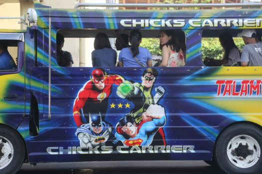 The jeepney says Chick Carrier. They weren't kidding.