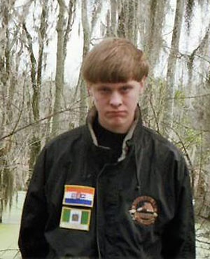 Dylann Roof with a South African apartheid and Rhodesia flag: PIC -  Fecebook