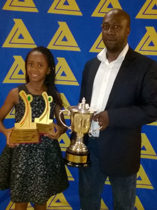 Tanya with her dad after picking up her awards