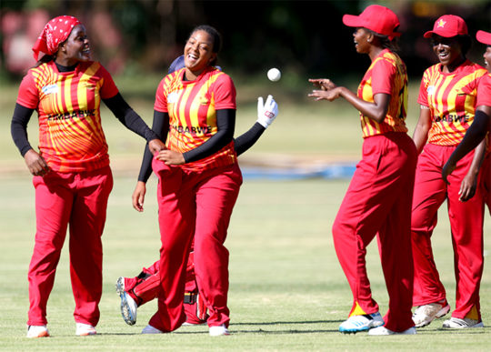 Tasmeen-Granger-(center) congratulated by her team mates after she dismissed Prico Nakitende