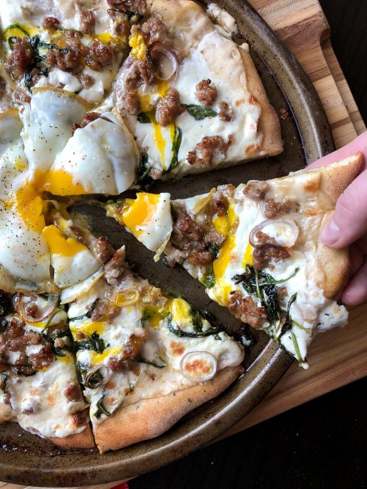 White pizza with egg on top