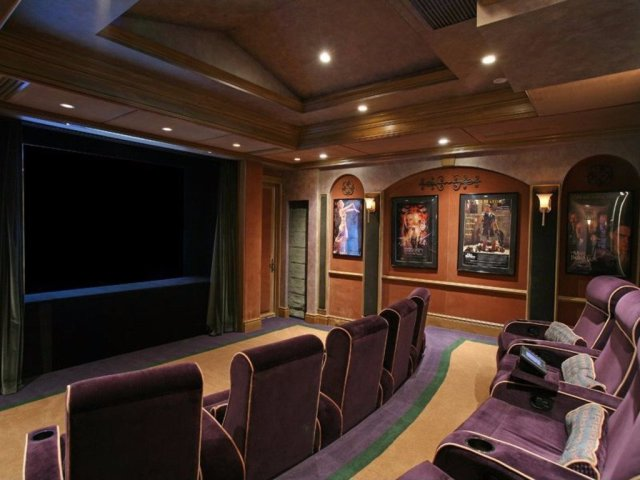 the-home-theater-can-accommodate-20-guests-in-plush-seats.jpg