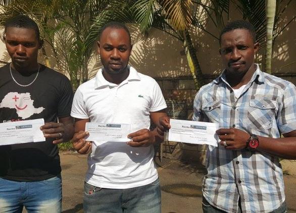 Haitianos têm recibo de pagamentos feito a bispo/Foto: Edgar Maciel/CBN