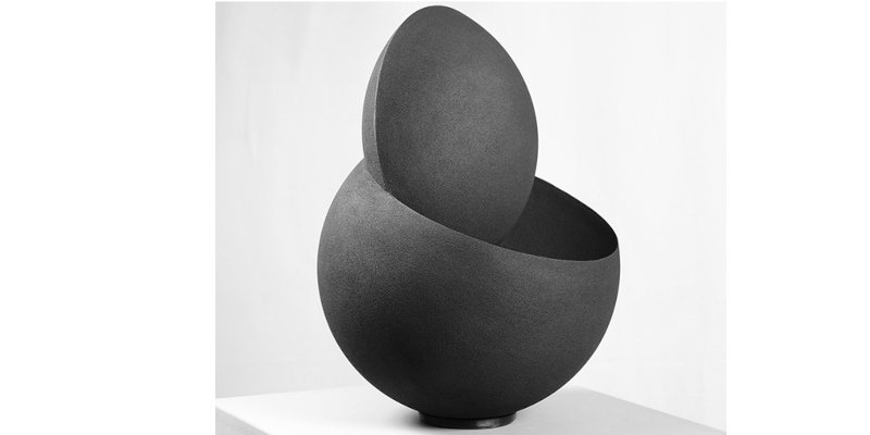 "Dario Santacroce's ""Spherical Creation X."" A spherical sculpture made of sandstone."