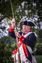 Adjutant Bob Davis explaining a musket