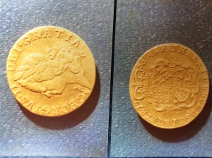The coin (both sides)