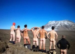 Naked men looking at Kilimanjaro