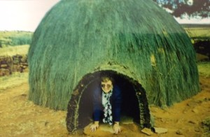 Paula in a thatched hut