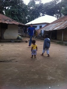 Oscar playing football with Brian and another little lad