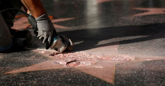 A repairman restores Donald Trump's Star on the Hollywood Walk of Fame.