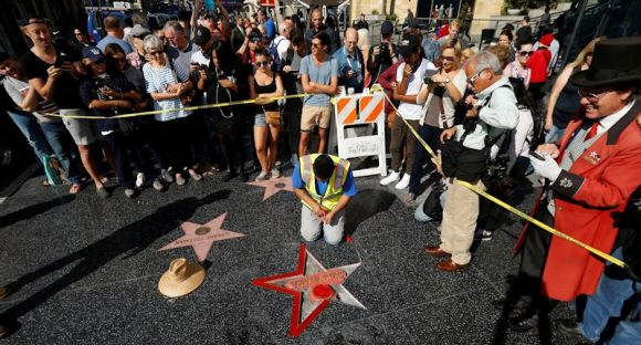 Donald Trump's star on the Hollywood Walk of Fame is repaired on October 26, 2016 after being vandalized. Photo by Mario Anzuoni..