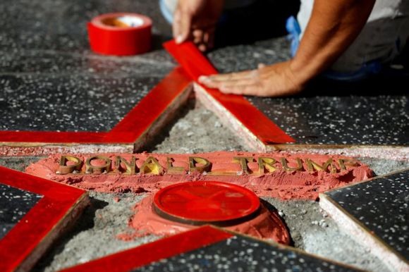 Repairs are made to Donald Trump's star on the Hollywood Walk of Fame after a vandals wreaked his havoc. Photo by Mario Anzuoni.