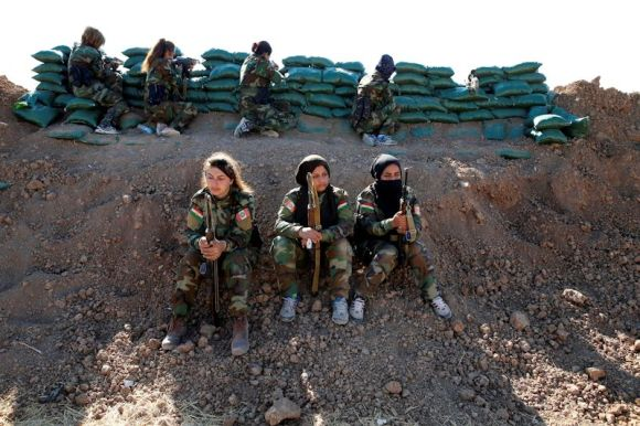 Iranian Kurdish female fighters in the area of Bashiqa not far from Mosul, talk with Reuters. Photo by Ahmed Jadallah on Oct. 3, 2016.