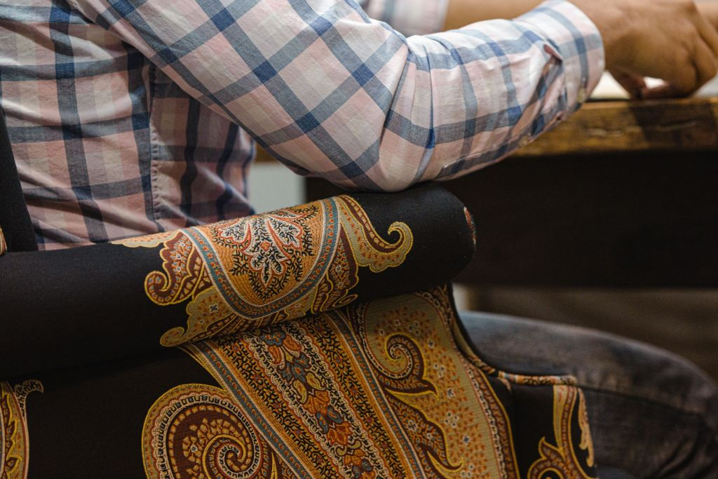 Man sitting in ornate chair