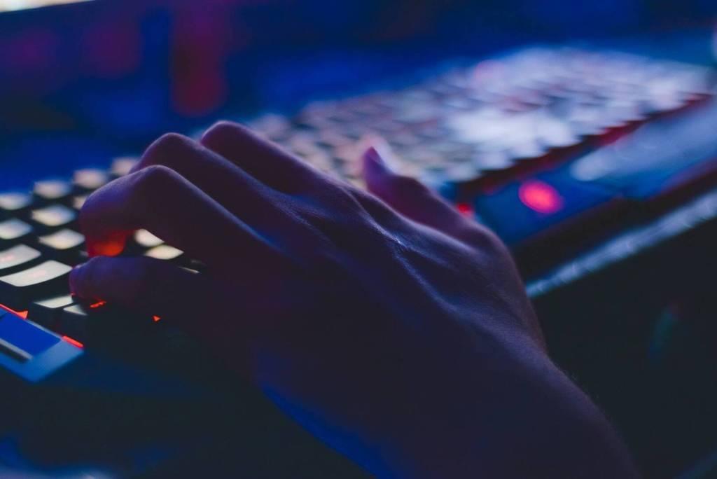 hand on keyboard in dark setting