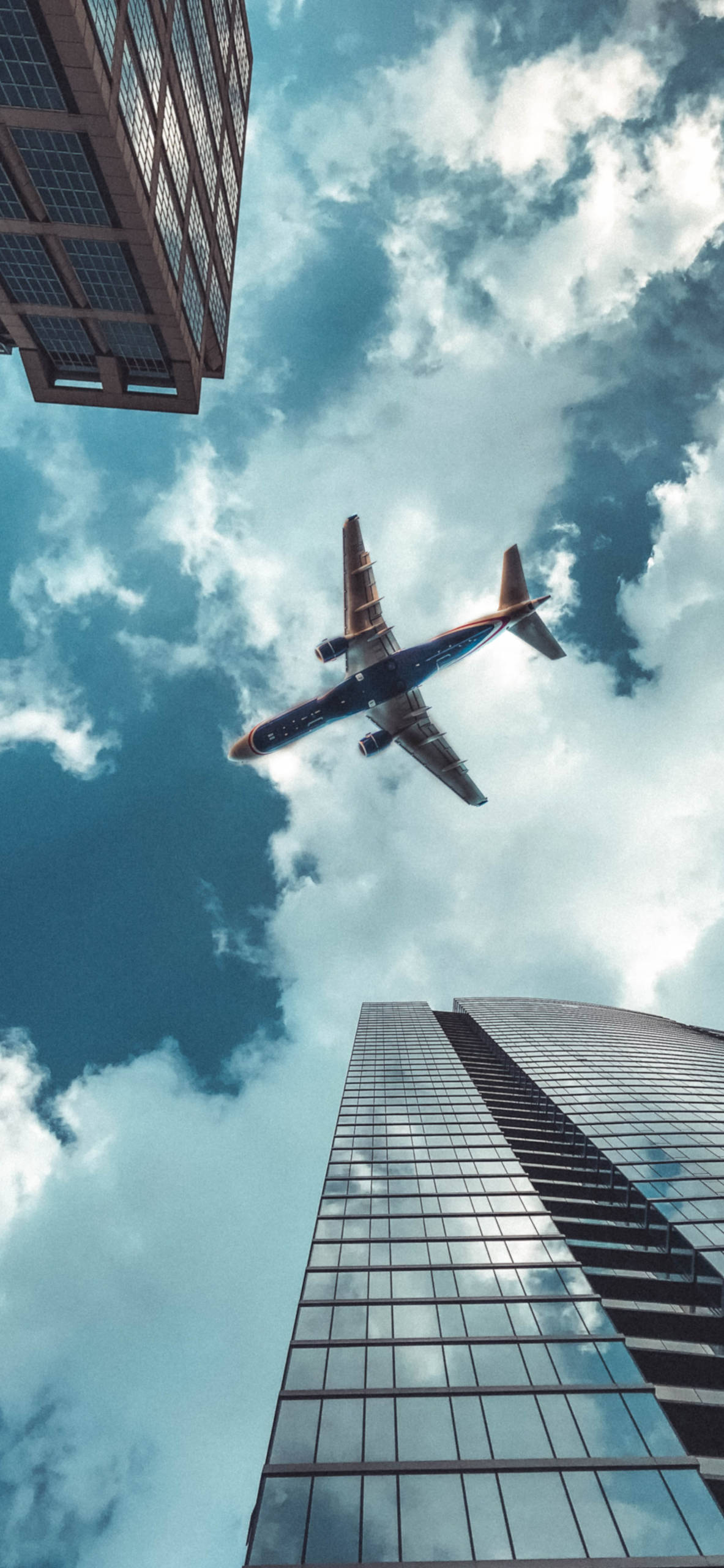 iPhone wallpapers airplane midle buildings Airplane