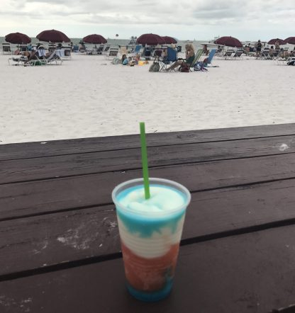 Miami Vice, the signature drink. Part Pina Colada, Part Rum Runner, with a Blue Curacao Floater