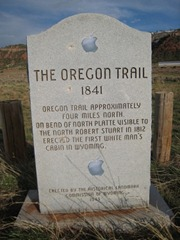 Oregon Trail sign with Apple logo