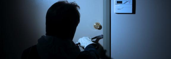 Burglar breaking in