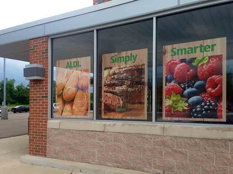 see-through mesh perforated window vinyl invisa-view display windows graphics print printing printer graphics design visual merchandising installation visuals