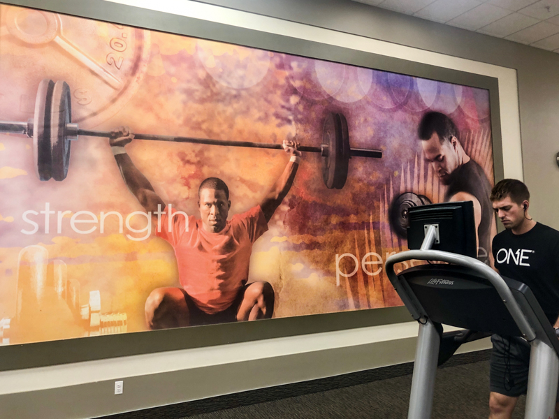 textured wall vinyl graphics adhesive vinyl rough wrap application gym signage sign printed graphic motivational artwork fitness display gym artwork retail