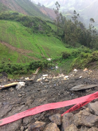 No one to rescue. The truck that fell is upside-down at the bottom of the landslide.