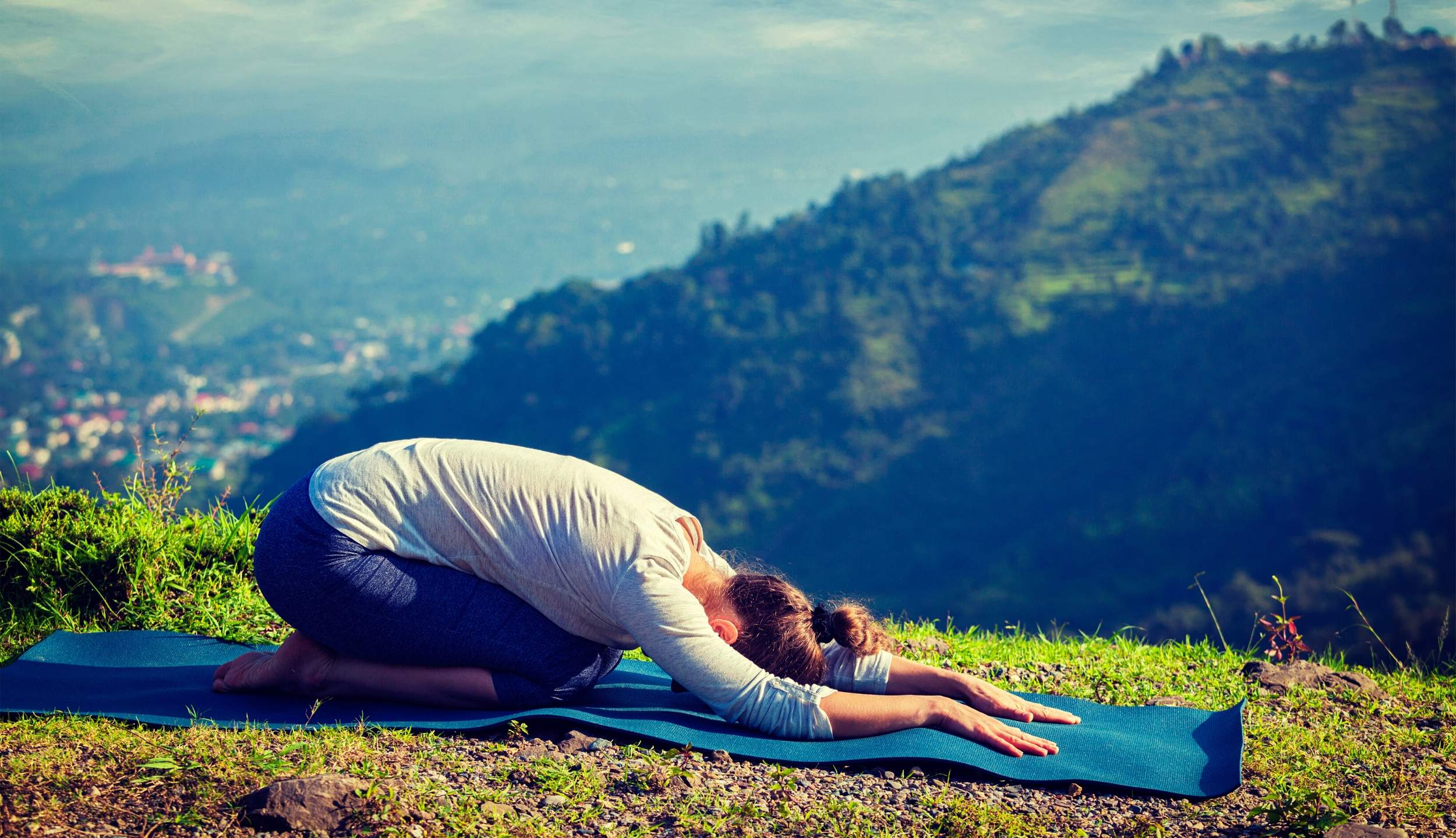 Woman doing child's pose in yoga. Yoga for High Blood Pressure