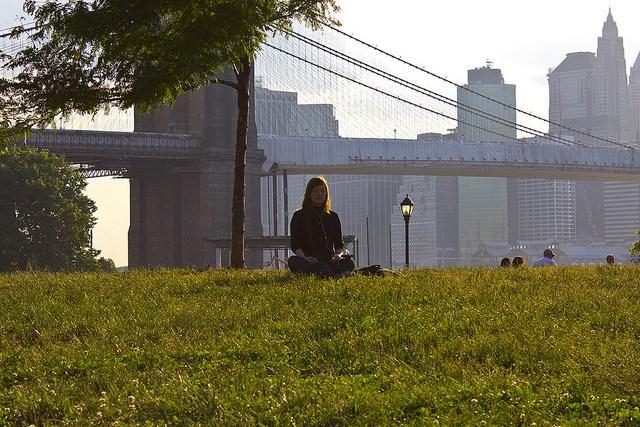 Woman meditating outside