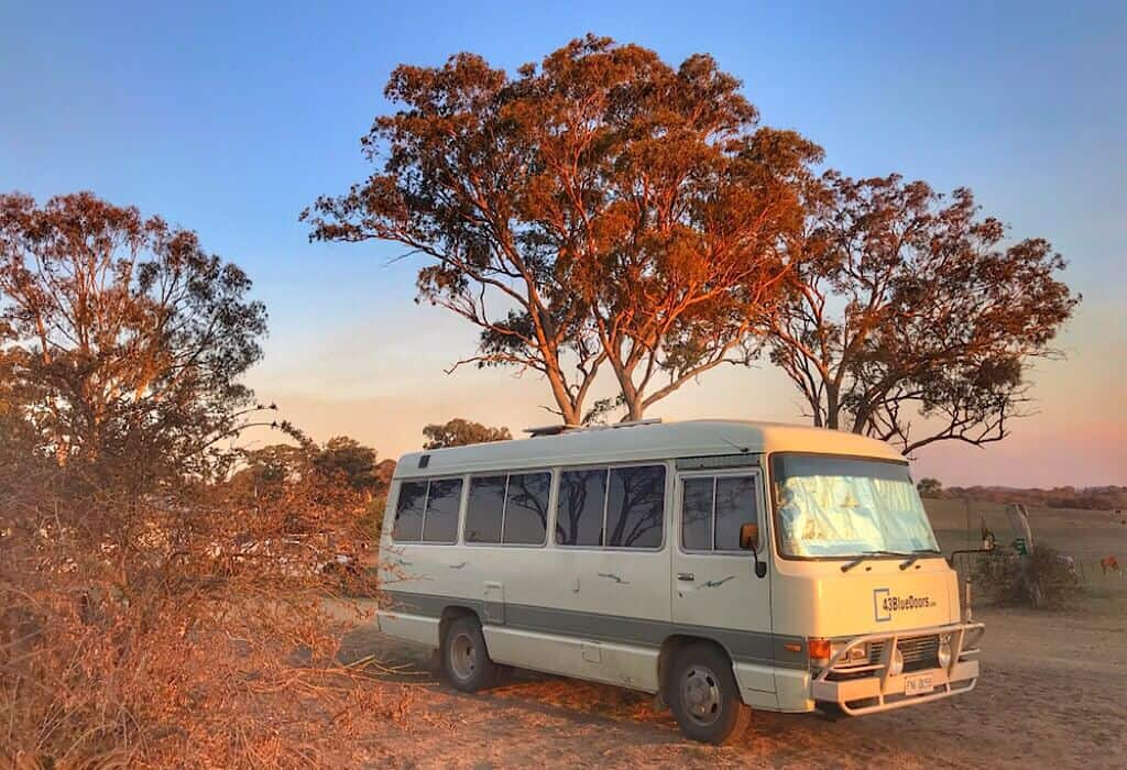 Our Toyota Coaster Lil' Beaut camped in the town of Wollomombi as the sun sets