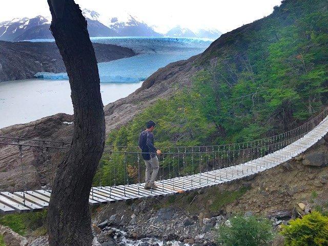 Trin crossing the bridge towards Glacier Grey in Torres National Park