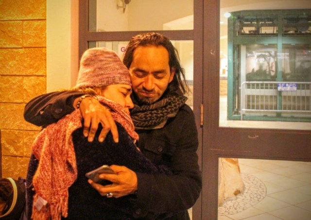 Equipto hugs his sister Sandra Vasquez outside mission police station. Photo by Sana Saleem