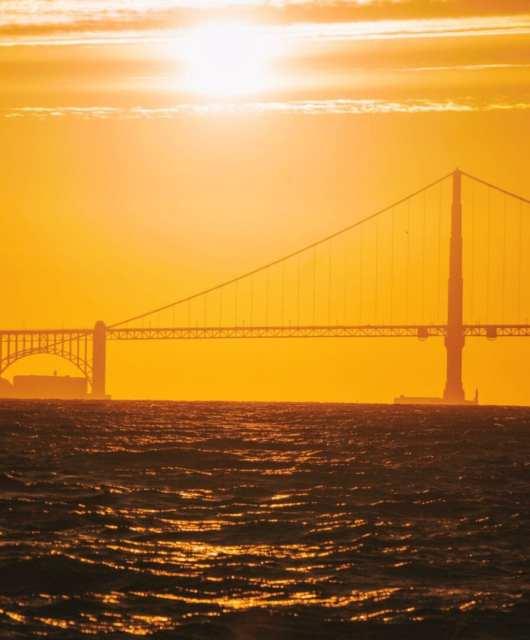 Sun setting over the Golden Gate Bridge. Photo: Kyle Legg, 49Miles.com.
